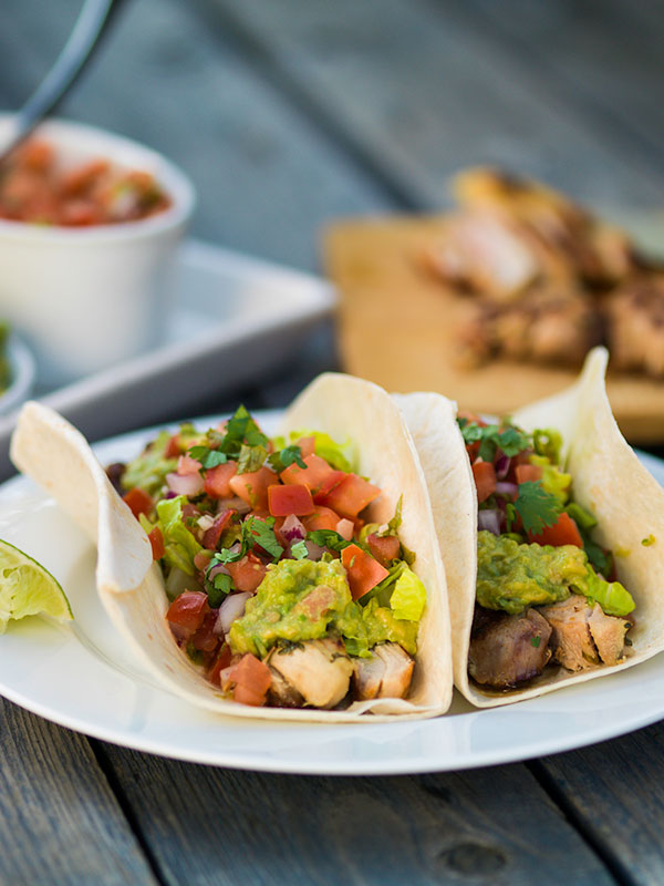 Tequila-Lime Chicken Tacos With Charred Limes Recipe — Dishmaps